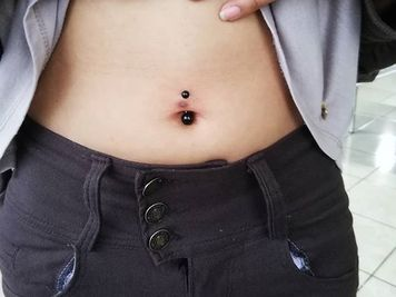 belly button piercing cost