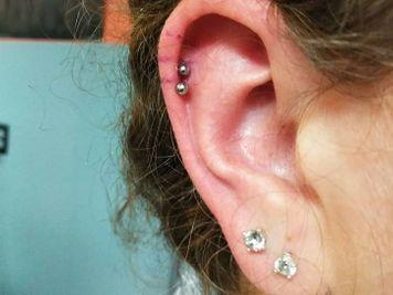 black stud double cartilage piercing