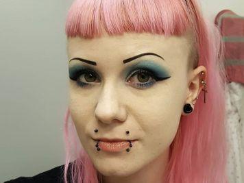 canine bites facial piercing
