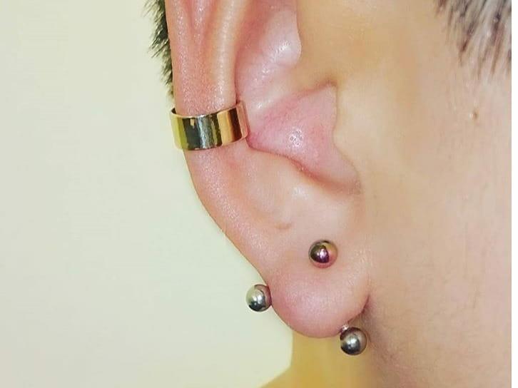 curved barbell lobe jewelry