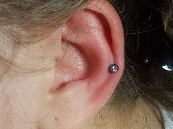 ear auricle piercing