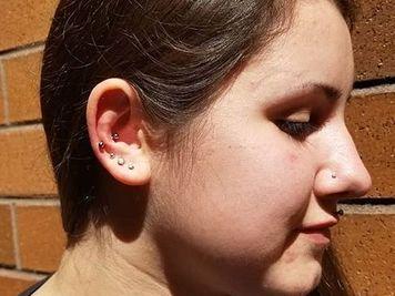 earlobe and snug piercing