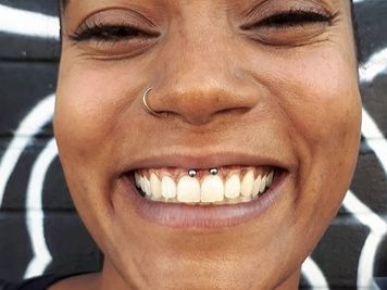 how to take out smiley piercing