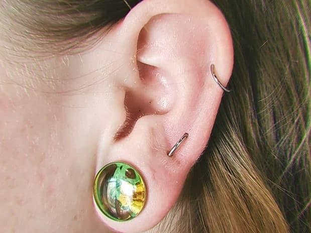 infected orbit piercing