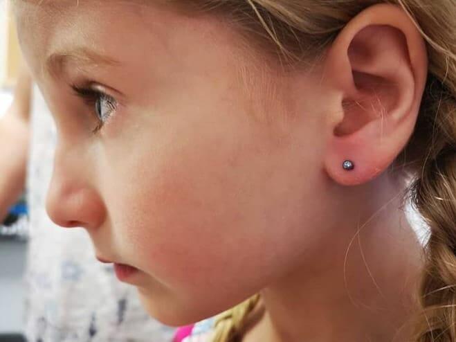 young girl earlobe piercing