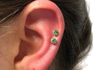 middle double cartilage piercing